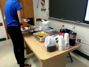Attendees getting food before the meeting started.