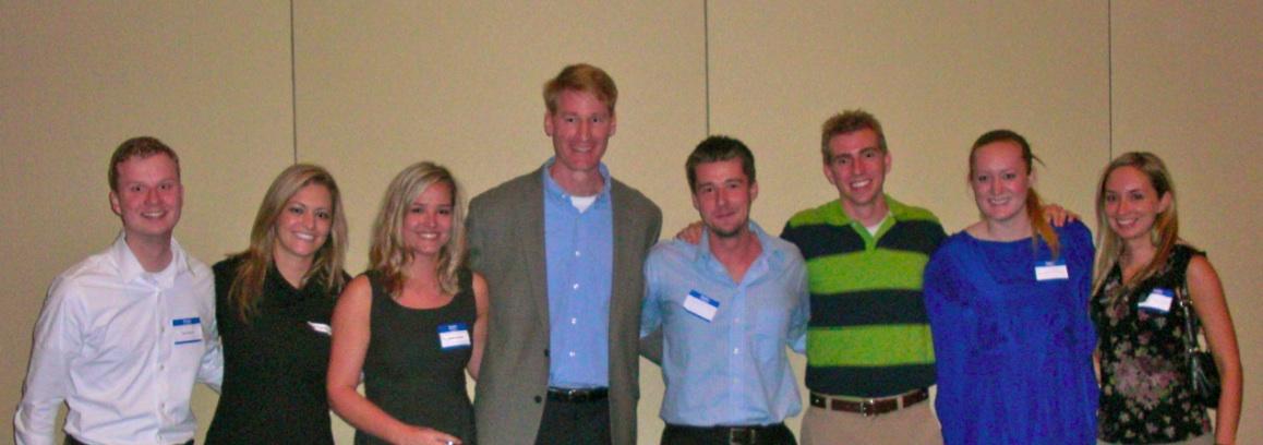 Dr. Joseph Hartman takes a group photo with alumni