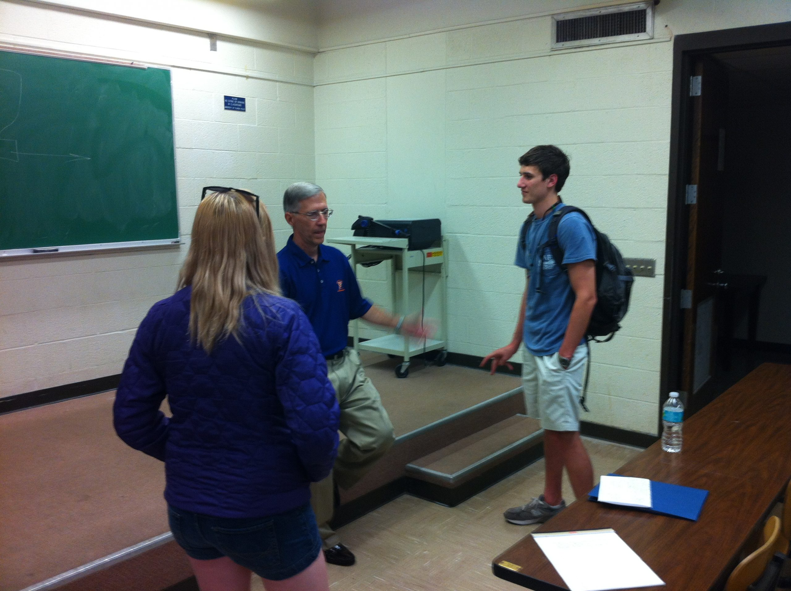 """William """"Bill"""" G. Read, III speaks with students in a classroom"""