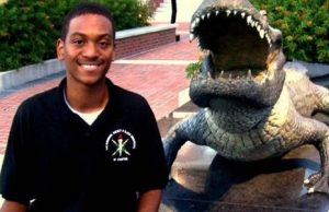 Sheldon Anderson in front of the UF gator statue