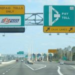 Cars travel through a toll road