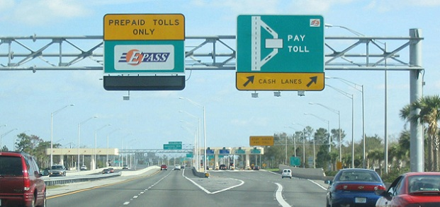 Cars travel through a toll road