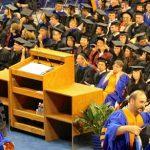 Students sit through a graduation ceremony