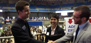 Two men shake hands at the career showcase