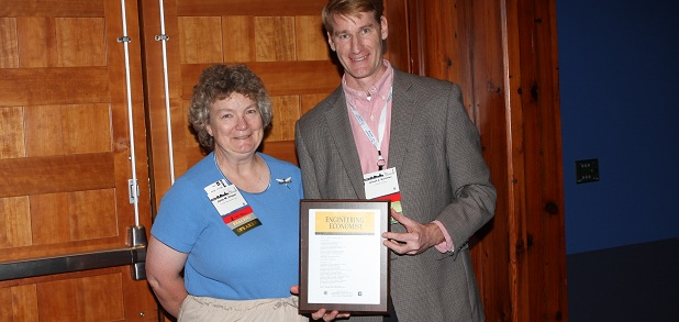 Jane Fraser presents Dr. Joseph Hartman with a commemorative plaque
