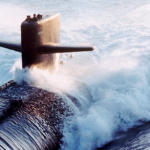 A submarine cuts through ocean waters