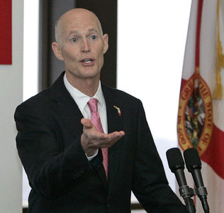Rick Scott delivers a speech