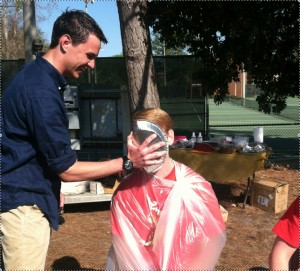 Hartman receives a pie to the face