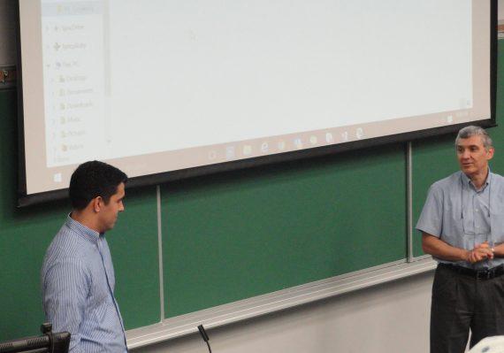 Ryan Strobel (Left) and Dr. Serdar Kirli (Right) deliver a presentation