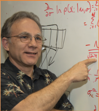 Dr. Paul Gader points to a set of equations on a whiteboard